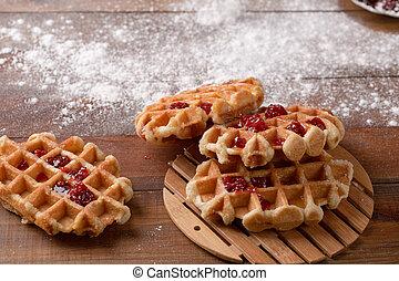 Tasty homemade waffle and strawberry jam