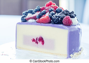 Tasty Ice-cream cake with fresh berries on a glass plate. Light background. Shallow depth of field