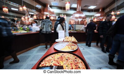 tasty italian pizza in cafe where sells lot of good food,...