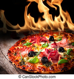 Tasty italian pizza with flames in background