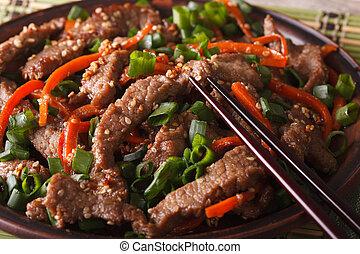 Tasty Korean bulgogi beef with carrot and onion macro....
