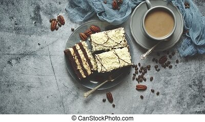 Tasty layered cake sprinkled with white chocolate. Served ...