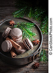 Tasty macaroons with cinnamon and chocolate for Christmas