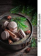 Tasty macaroons with cinnamon and chocolate for Christmas