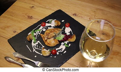 tasty meal dish with glass of vine in restaurant