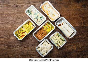 Tasty Meals In Foil Containers On The Table