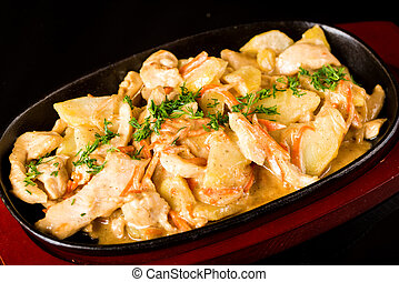 Tasty meat with potatoes