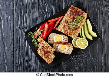 tasty meatloaf with hard boiled egg filling