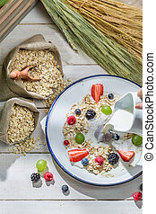 Tasty oat flakes with fresh fruits for breakfast