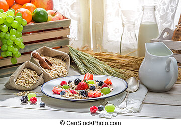 Tasty oatmeal with fresh fruits for breakfast