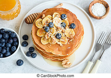 Tasty Pancakes with Bananas, Blueberries, Walnuts and Honey