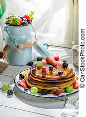 Tasty pancakes with fresh fruits for breakfast