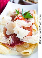 tasty pasta with roast ham on the t