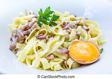 pasta with roast ham on the table