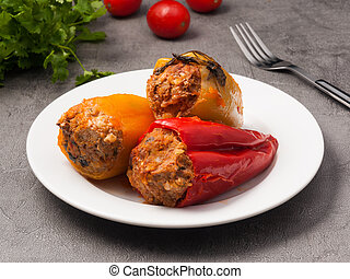 pepper stuffed with meat and rice on a white plate