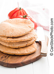Tasty pita bread. - Tasty pita bread on white kitchen table.