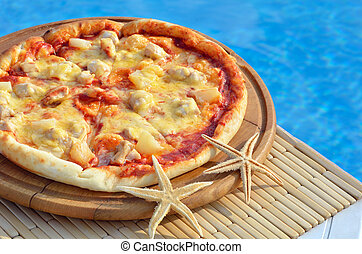 Tasty pizza decorated with starfishes.