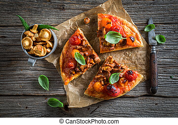 Tasty pizza made of noble mushrooms and tomatoes