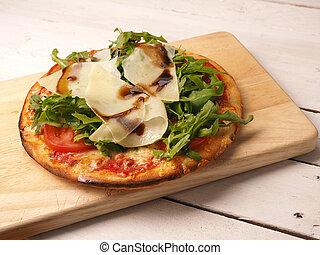Tasty pizza on wooden board