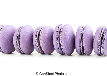 Tasty purple macarons on white background