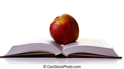 tasty red apple on the book