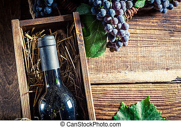 Tasty red wine in wooden box