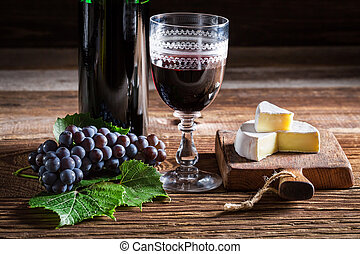 Tasty red wine with cheese
