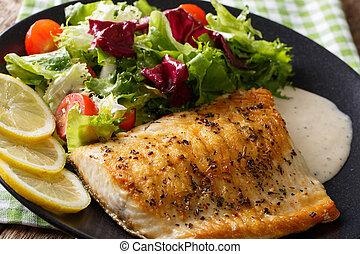 Tasty roasted fish fillet Arctic char and fresh vegetables...