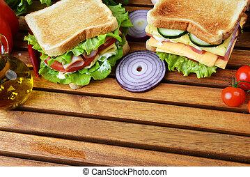 tasty sandwich - Fresh and tasty sandwich on wooden cutting...