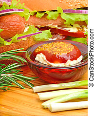Tasty sandwiches with green lettuce, ham, green onion and sauce,
