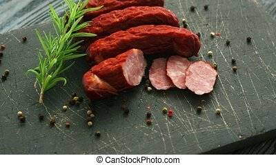 Tasty sausages and spices - Twig of fresh rosemary and seeds...