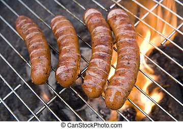 tasty sausages on the summer grill party