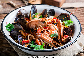 Tasty seafood soup with mix of shellfish