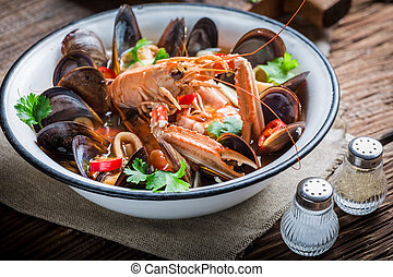 Tasty seafood soup with mussels and langoustines