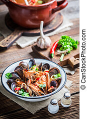 Tasty seafood soup with shrimps and mussels