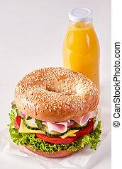 Tasty sesame ham sandwich and fresh orange juice