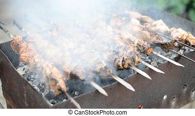 Tasty shashlik on the grill.