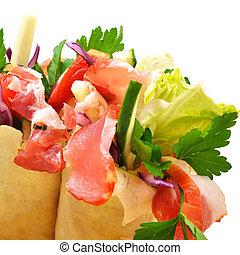 Tasty shawarma with fresh vegetables and meat, lavash, pita, ap
