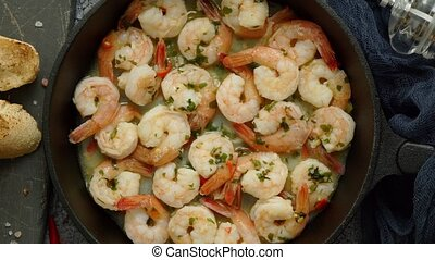 Tasty shrimp tails fried in butter with, garlic, parsley, ...