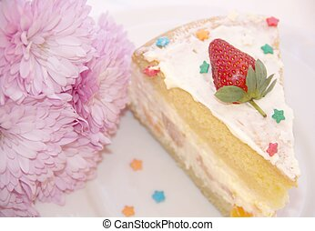 Tasty slice of cake with strawberry and flowers