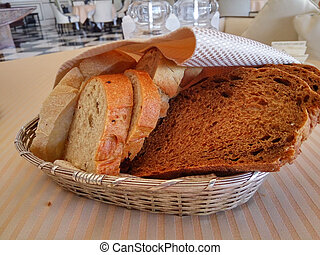 Tasty slices of bread - Fresh cutted bread in the basket for...