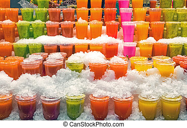 Tasty smoothies at a market - Tasty fruit smoothies at the...