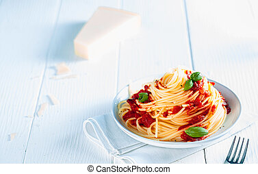 Tasty Spaghetti in Plate on White Table Background