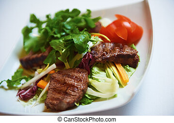 tasty bbq meat food, juicy beef steak with grilled cheese and salad in restaurant