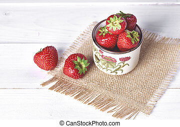 Tasty strawberry in the retro cup