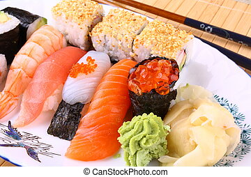 Tasty sushi with red caviar and wasabi