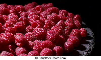 Tasty sweet fruit - ripe raspberry rotating background. Berries is full of antioxidant. Proper vegan nutrition. Healthy lifestyle concept. High quality 4k footage