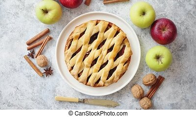 Tasty sweet homemade apple pie cake with cinnamon sticks,...