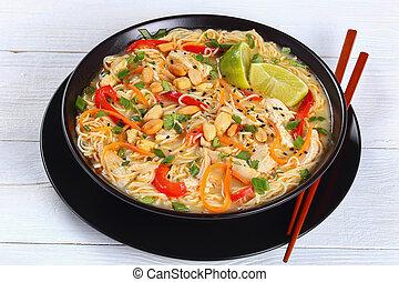 tasty Thai Chicken noodle soup, close-up