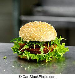 Tasty yummy veggie quinoa chickpeas burger with tomotoes, lettuc